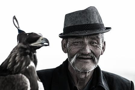 animal, bird, black-and-white, elderly, hat, man, mustache