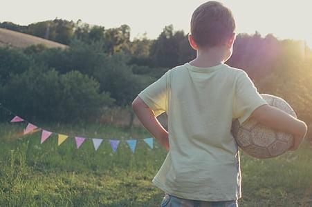 boy, holding, soccer, ball, green, grass, field