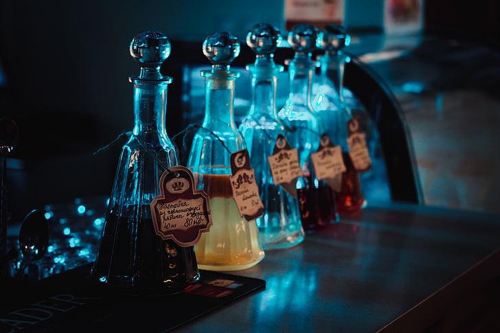 ampolla, vidre, condiments, taula, llums, blau, bokeh