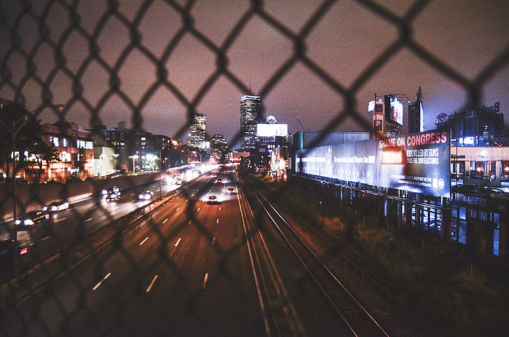 billboard, buildings, city, night, road, urban, wire mesh