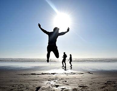 silhouette, man, jumping, near, woman, blue, sky