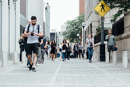 cameras, city, crossing, crowd, downtown, group, lamppost