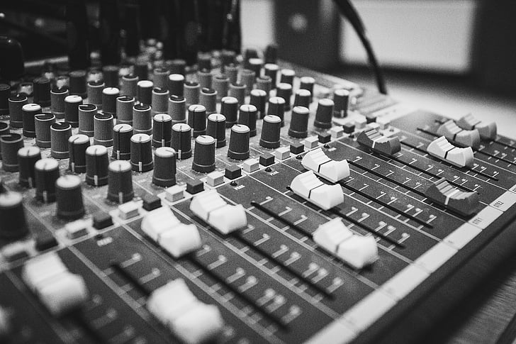 adjusting, audio, black-and-white, close-up, console, knobs, mixer