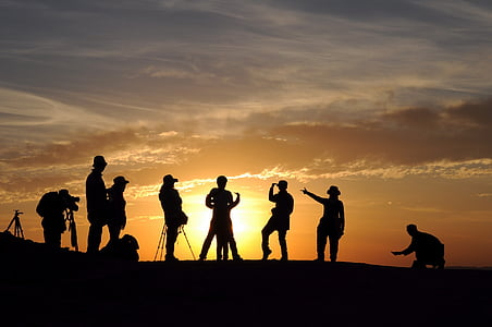 in xinjiang, ghost city, silhouette, people, sunset, joke, together