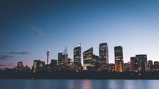 buildings, city, city lights, cityscape, lights, river, sky