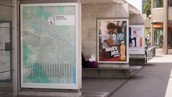advertisement, billboard, outside, poster, train station, one person, day