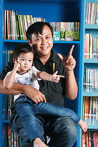 father, son, library, happy, kid, sitting, pose