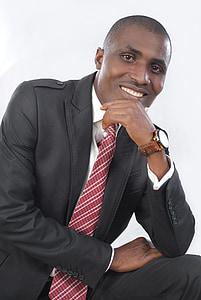male portrait, man, official, suit, smile, tie, open door