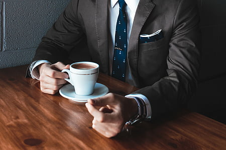 coffee, cup, man, mug, person, saucer, suit