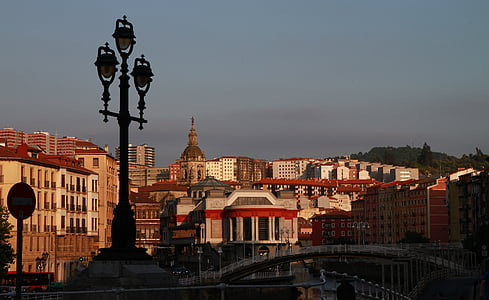 bilbao, spain, cityscape, city at dusk, city street, street lamp, dusk