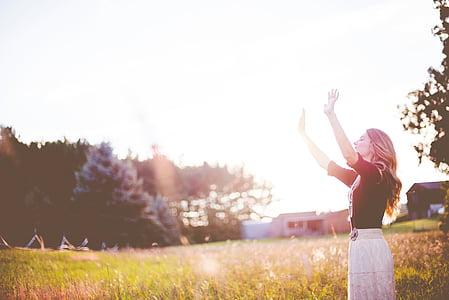 woman, wearing, black, top, raising, hands, near