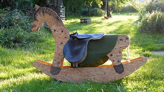 rocking horse, toys, wooden horse, children toys, children, garden, evening light