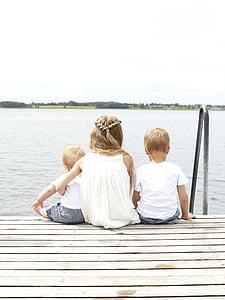 children, dock, kids, lake, people, sitting, water