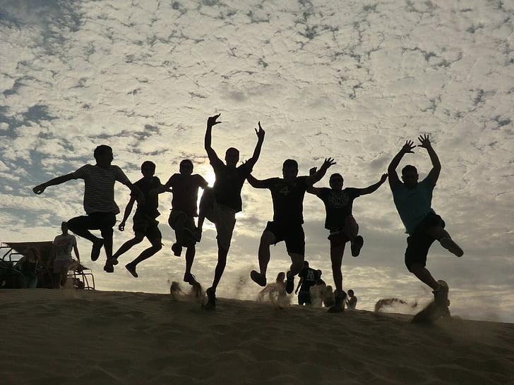 people, sand, desert, jump, joy, silhouettes