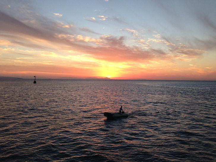 západ slnka, Červené more, rybár