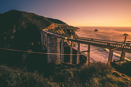 beach, bridge, coast, dawn, dusk, grass, ocean