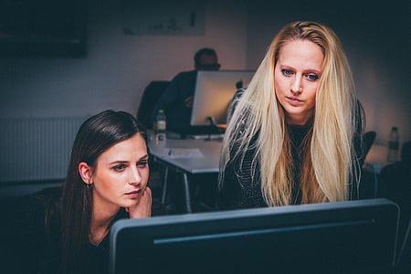 two, women, s, watching, black, monitor, computer