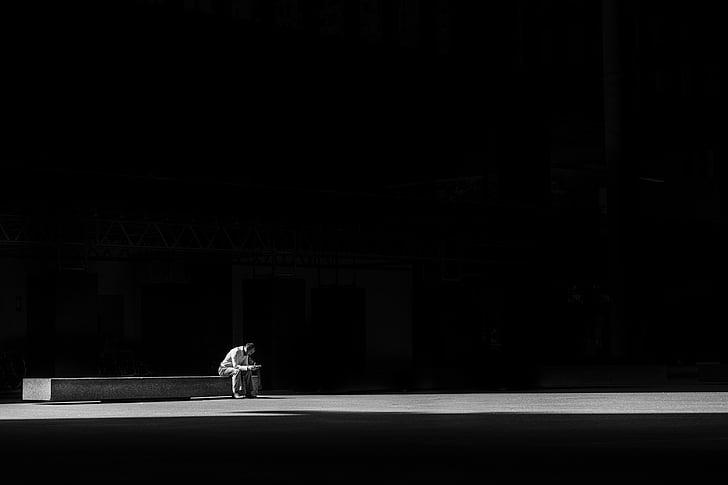 dark, light, man, person, sitting, solo, one person