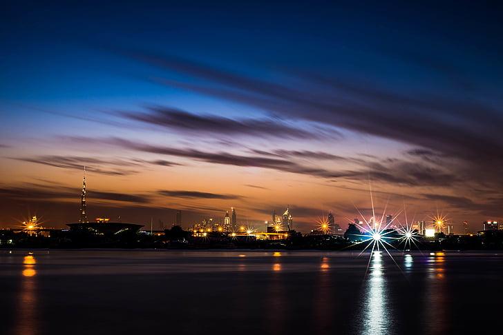 city, clouds, dubai, light glare, night, ocean, sea