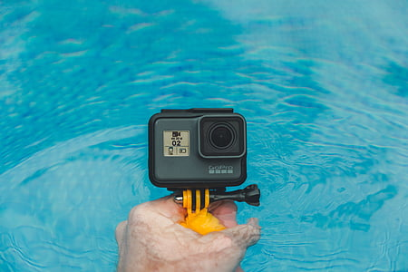 person, holding, gopro, action, camera, putting, body
