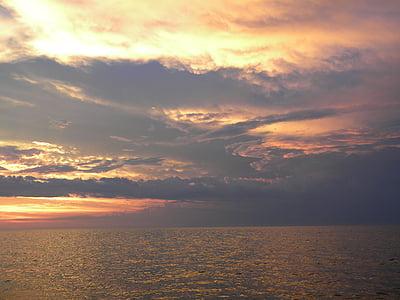 posta de sol sobre l'oceà, els Cayos de Florida, postes de sol, oceà, platja