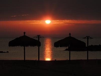 dawn, sun, sea, sand, umbrellas