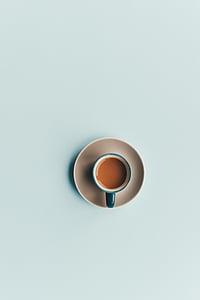 blue, ceramic, mug, saucer, containing, brown, liquid