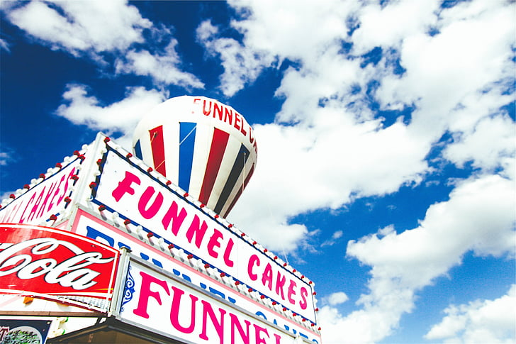 person, taking, photo, funnel, cakes, signage, funnel cakes