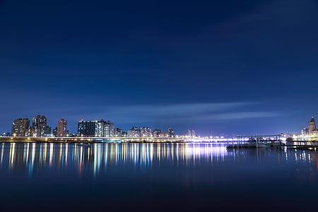 body, water, behind, city, evening light, lights, illuminated