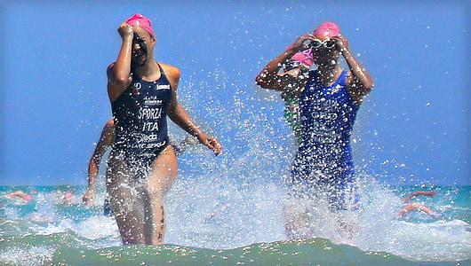 nedadors, competència, triathalon, platja, atletes, gimnàs, dones