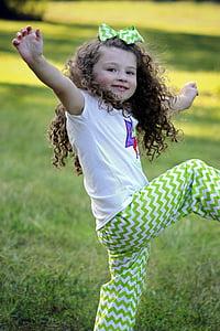 wearing, white, top, green, bottoms, playing, grass