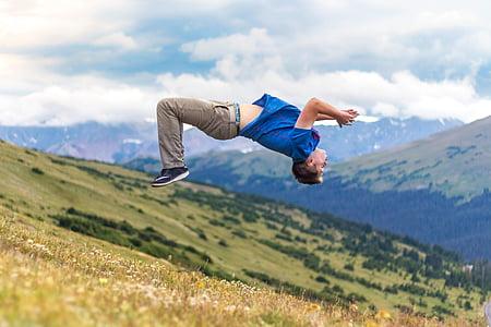 action, adult, daylight, grass, landscape, leisure, man