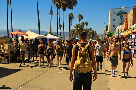 boardwalk, crowd of people, people walking, beach side, beachside, man, backpack