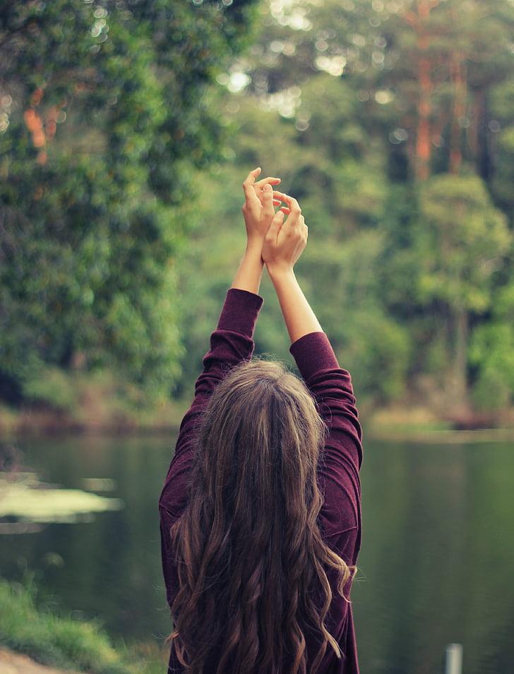 woman, raising, hands, facing, lake, yoga, stretch