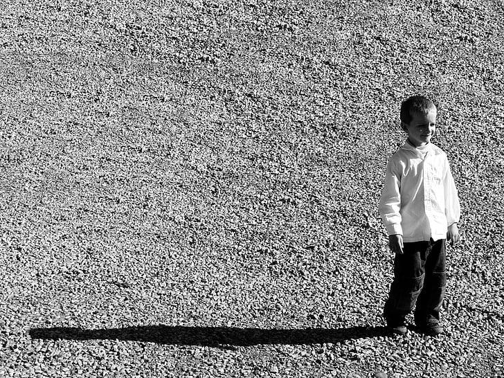black and white, kid, child, boy, portrait, gravel, shadow