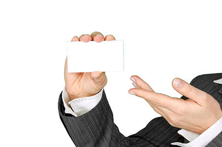 person, holding, white, card, wearing, black, pin