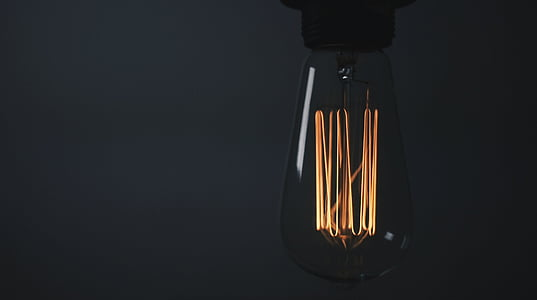 close-up, electricity, light, black background, light bulb, lighting equipment, illuminated