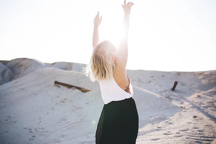 woman, wearing, white, top, black, skirt, raising