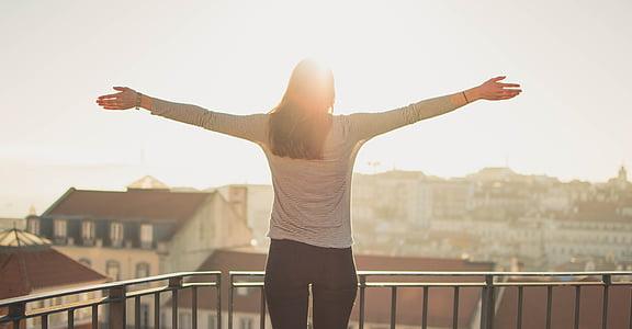 balcony, person, standing, sunshine, woman, human arm, limb