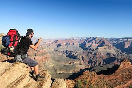 man, sitting, brown, rock, mountain, daytime, nature