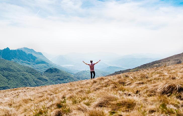 adventure, clouds, grass, grassland, landscape, man, mountain top