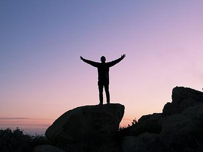 silhouette, man, open, arms, rock, sunset, dusk